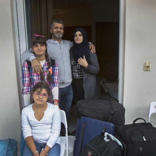 "ATHENS, GREECE (EU) 05-29-2017: The Al Rahmoun family arrive at their new apartment in Athens after living in a refugee squat in an abandoned school building for the past few months. They are being sponsored by two sisters in New York who raised money for them through HumanWire's Tent-to-Home Project, the new apartment is a welcome relief from the refugee camps they had been living in, one with conditions so dire that the mother, Manar, had resorted to sucking on the ears and faces of her children to keep them clean. They found the new apartment so blessed, it was ""like a wedding feeling,"" Hosam said, a place where their children liked sitting in the bathtub. The Al Rahmoun's fled the war in Syria and have been refugees for over a year, and are now awaiting a ruling on their asylum application in Greece (EU)."