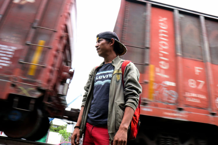 GUADALAJARA, MEXICO  07/11/2017: Enrique, a migrant from Honduras, waits for the right moment to jump aboard a moving freight train, known as La Bestia, in Guadalajara. Migrants use the freight trains on their journey to the United States to more quickly traverse the length of Mexico. This mode of travel is extremely dangerous and illegal. Guadalajara, roughly the midway between Central American and the U.S. border. Enrique says this this his 4th attempt to make it into the U.S., previous attempts resulted in being deported back to Honduras. If he makes it across, he plans to look for his a half-sister living in Trenton, NJ.
