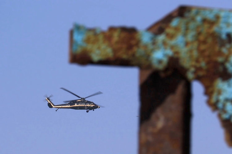 TIJUANA, MEXICO  03-14-2019:A CBP helicopter flies past the border wall shortly after a group of migrants pushed their way through the fence and ran north along the beach into the United States. They were later captured by United CBP agents, who said they arrested about 52 migrants, including 23 men, between the ages of 18 to 53, 12 women aged 21 to 50, and 17 minors between the ages of 1 and 14 years old. They were mostly from Honduras and came to Tijuana in a caravan. As they broke through the fence and ran down the beach, some dropped clothes and shoes from the backpacks, as some people on the Mexico side cheered them on.