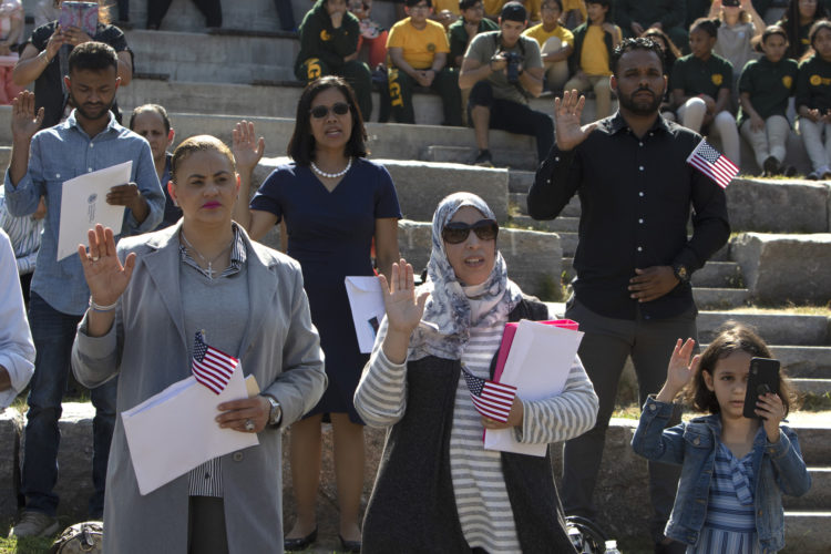 PATERSON, NJ  10-02-2019 NATURALIZATION CEREMONY AT GREAT FALLS:  Rachida El Ghyati of Paterson takes the Oath of Allegiance to the United States. She is from Morocco. The Paterson Great Falls National Historical Park (NPS), in partnership with U.S. Citizenship and Immigration Services (USCIS), held a naturalization ceremony in the park's new amphitheater where 40 new citizens, mostly residents of Paterson, took the Oath of Allegiance to the United States.
