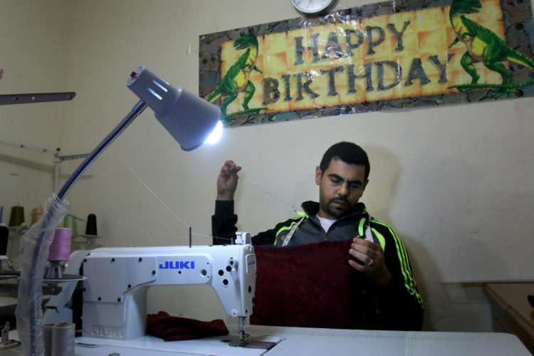 ELIZABETH, NJ   04/03/2016   SYRIAN REFUGEE FAMILIES RESETTLED IN ELIZABETH:  Mohammed Zakkour works at his new sewing machine in the family's apartment in Elizabeth where the IRC resettled them. The Bnai Keshet Synagogue in Montclair raised money to buy the swing machine so Zakkour, who was a tailor back in Syria, would have a way to generate income. The Zakkour's fled their home in Homs, Syria, after it became unsafe due to aerial bombings, They fled to Jordan where they were remained for 4-years before being resettled in Elizabeth by the IRC.