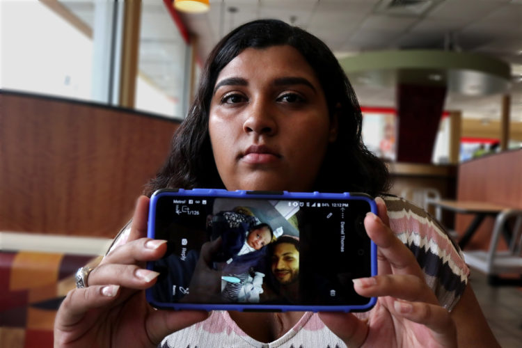 NEWARK, NJ  07-17-2018: NEWARK, NJ  07-17-2018  IMMIGRATION PROJECT: Kasandra Serrano, 21, shows a photo of her fiancé Daniel Castro, 28, and their young child Ismael. Danny was taken into custody by Newark Police in June 2018 and turned over to ICE despite Newark's Sanctuary City policy. Castro, who is undocumented but has no criminal record and did not commit any offense the evening of his arrest, was falsely arrested, and Newark Police admit they made a mistake in violating the city's own Sanctuary City policy. On the night of his arrest, Castro was returning from shopping for baby formula when he was stopped by police and reluctantly gave his name when they arrested him for an outstanding ICE warrant from many years ago for which he said he was never notified. After many months of being held at the Elizabeth Detention Center (ICE) he was deported to his native Nicaragua where he currently awaiting a status hearing in New Jersey. The couple has a 9-month old baby boy, Ismael, and since Danny's arrest Serrano has been living with her mother, sisters, and their young children in a small apartment in Newark, and says she cannot support herself and the baby without government and family assistance.