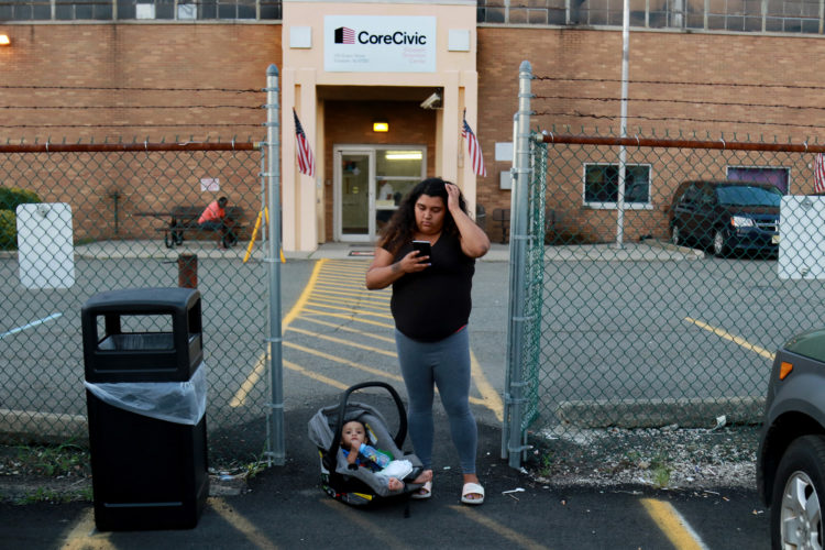 NEWARK, NJ  08-08-2018  IMMIGRATION STORY: Kasandra Serrano, 21, waits with her 9-month old son Ismael as she calls an Uber outside the ICE Detention Center in Elizabeth to visit her fiancé who is in detention there. Her fiancé Daniel Castro Castro 28, was taken into custody by Newark Police in early June for an outstanding warrant, while out getting bottled water for baby formula, and now currently is being detained by ICE at the Elizabeth Detention Center. Castro is undocumented and is facing deportation to his native Nicaragua. The couple has a 9-month old baby boy, Ismael. Serrano says he doesn't know how she will support herself and baby Ismael if he is deported.