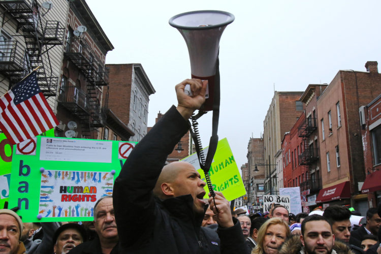 "PATERSON, NY  02/05/2017: Senator Cory Booker uses a megaphone to rally protesters during the ""March for Peace and Decency"" in downtown Paterson. The crowd of roughly 2,000 included scores of religious leaders, elected officials, activists, and local families who  marched through downtown before gathering at the Great Falls National Park. Senator Robert Menendez and Congressman Bill Pascrell, Jr. also joined the march. Rally organizers said they hoped to unite Christian, Jewish, Muslim, and other religious leaders, ""in a peaceful manner to demand justice for all."""