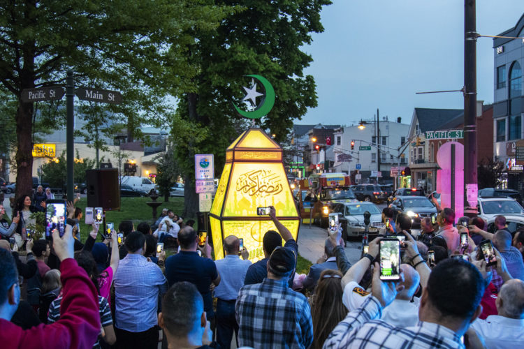 """PATERSON, NJ  05-04-19: At dusk on the eve of Ramadan a giant fanous, or lantern, was illuminated at the South Paterson Park on Main Street to usher in the holy month. After a ceremony led by Andre Sayegh, the city's first Arab-American mayor, people gathered to have their photo taken. 6th Ward Paterson Councilman Al Abdellaziz, who helped start the tradition four years ago, said, """"We want this to become a destination, """"it's like the Muslim Rockefeller Center Christmas tree."""""""