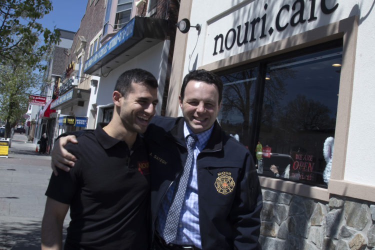 04-17-19PATERSON, NJ: Andre Sayegh, the mayor of Paterson, NJ, hugs George Noury (note his name and the restaurant name are spelled differently) who runs the Nouri.Cafe on Main Street in South Paterson. Sayegh is the first Arab-American to lead the city, which has had a long-thriving Middle Eastern immigrant community in the southern district of the city known as South Paterson. Sayegh's was born to a Syrian mother and a Lebanese father, and is Christian, was a longtime city councilman and was elected mayor in 2018.