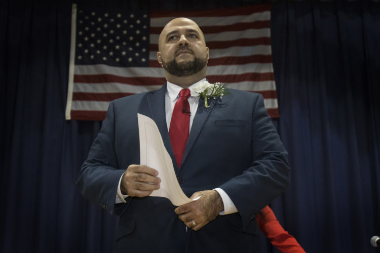 """PROSPECT PARK, NJ  01-05-2019: Mohamed T. Khairullah calls the Prospect Park city council to order after he was sworn-in by NJ Governor Phil Murphy after being elected to his fourth term as mayor of Prospect Park, NJ . Khairullah, who was born in Syria and came to the US as a refugee has become an outspoken leader in the Syrian-American community in here in the U.S. and abroad. """"Act Locally, Think Globally"""" was his main slogan during his recent re-election campaign. In addition to the governor, the ceremony was attended by roughly 250 people at Prospect Park School #1, including many several elected officials from around the region the Turkish Consul General was in attendance.Prospect Park has a population of just under 6,000 people, The borough is less than half a square mile, the smallest in Passaic County, and is located near the city of Paterson."""