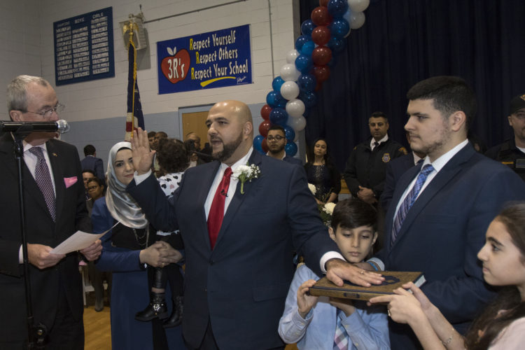 """PROSPECT PARK, NJ  01-05-2019: Mohamed T. Khairullah was sworn-in by NJ Governor Phil Murphy after being elected to his fourth term as mayor of Prospect Park, NJ . Khairullah, who was born in Syria and came to the US as a refugee has become an outspoken leader in the Syrian-American community in here in the U.S. and abroad. """"Act Locally, Think Globally"""" was his main slogan during his recent re-election campaign. In addition to the governor, the ceremony was attended by roughly 250 people at Prospect Park School #1, including many several elected officials from around the region the Turkish Consul General was in attendance.Prospect Park has a population of just under 6,000 people, The borough is less than half a square mile, the smallest in Passaic County, and is located near the city of Paterson."""