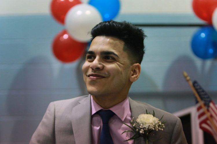 PROSPECT PARK, NJ  01/05/2019: Intashan Chowdhury smiles broadly as he is introduced at his first council meeting as the new Borough Administrator in Prospect Park, moments after being sworn-in by Mayor Mohamed T. Khairullah, a former teacher of his. Chowdhury, 22, is believed to be one of the youngest town managers in New Jersey history, if not the youngest, and the first of Bengali descent.