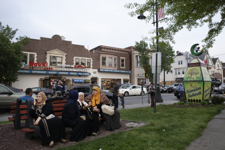 05-04-19  PATERSON, NJ: A group of older Muslim women sit on a park bench on Main Street in the heart of the Middle Eastern community in South Paterson at the start of Ramadan.