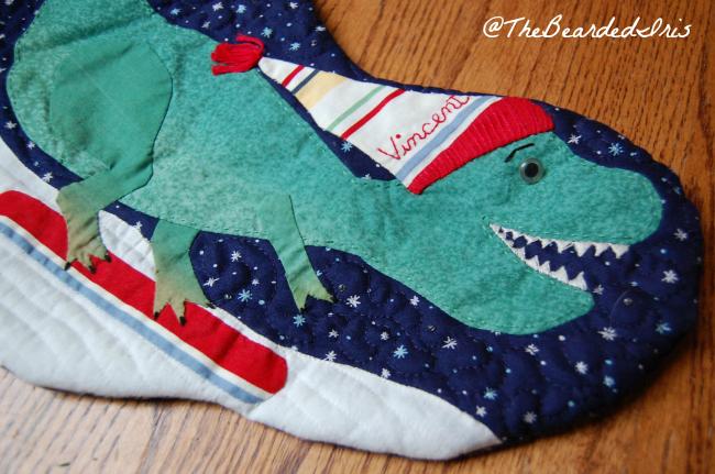 TheBeardedIris Handmade Dinosaur Christmas Stocking Closeup