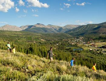 Group hiking down a hill.