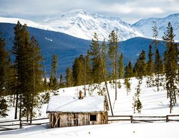 Devil's Thumb Ranch shack and Rocky Mountains.