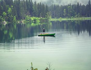 Flyfisher in a boat.