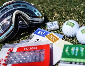 Ski mask, golf balls, pamphlets for ski and golf.