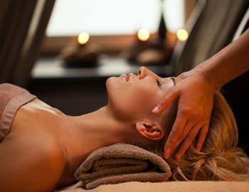 Woman receiving a head massage.