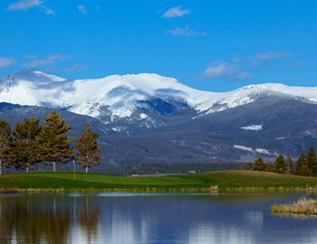 Pole Creek Golf Course and Rocky Mountains.