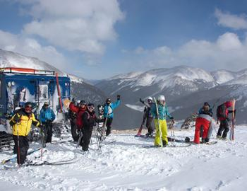 Skiers on top of a mountain.