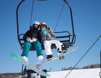 Couple on a ski chairlift.