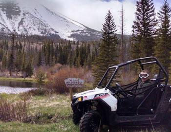 ATV rider near a lake.
