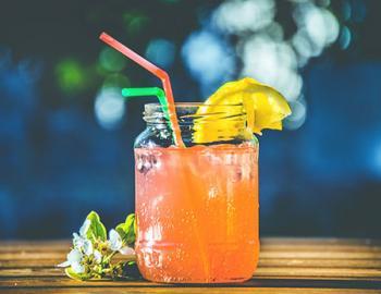 Mixed drink in a mason jar.