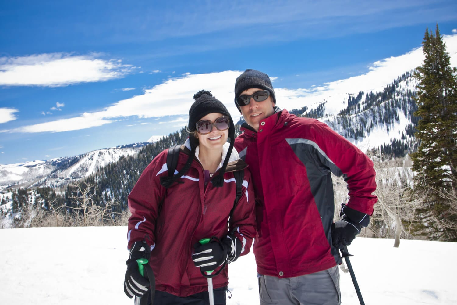 A outdoor enthusiast couple happily avoids crowds while skiing in Colorado.