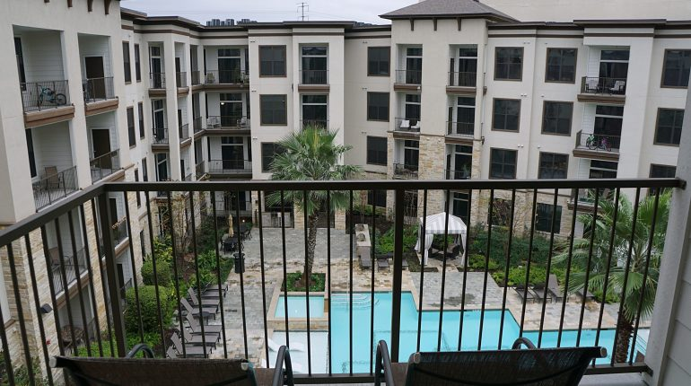 Balcony and pool view from the Florida Design at Premier Patient Housing.