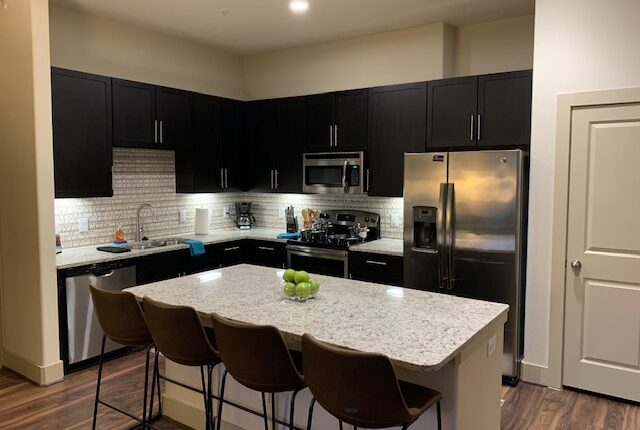 Full kitchen with fridge, oven, microwave and dining are on the island, from the South Carolina Design at Premier Patient Housing.