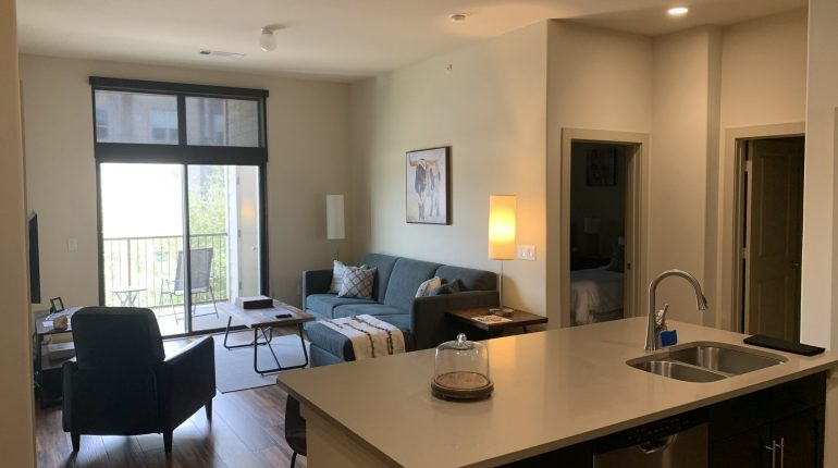 Kitchen view of living room, from the Montana design at Premier Patient Housing.
