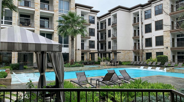 Balcony and pool view from the Alabama Design at Premier Patient Housing.