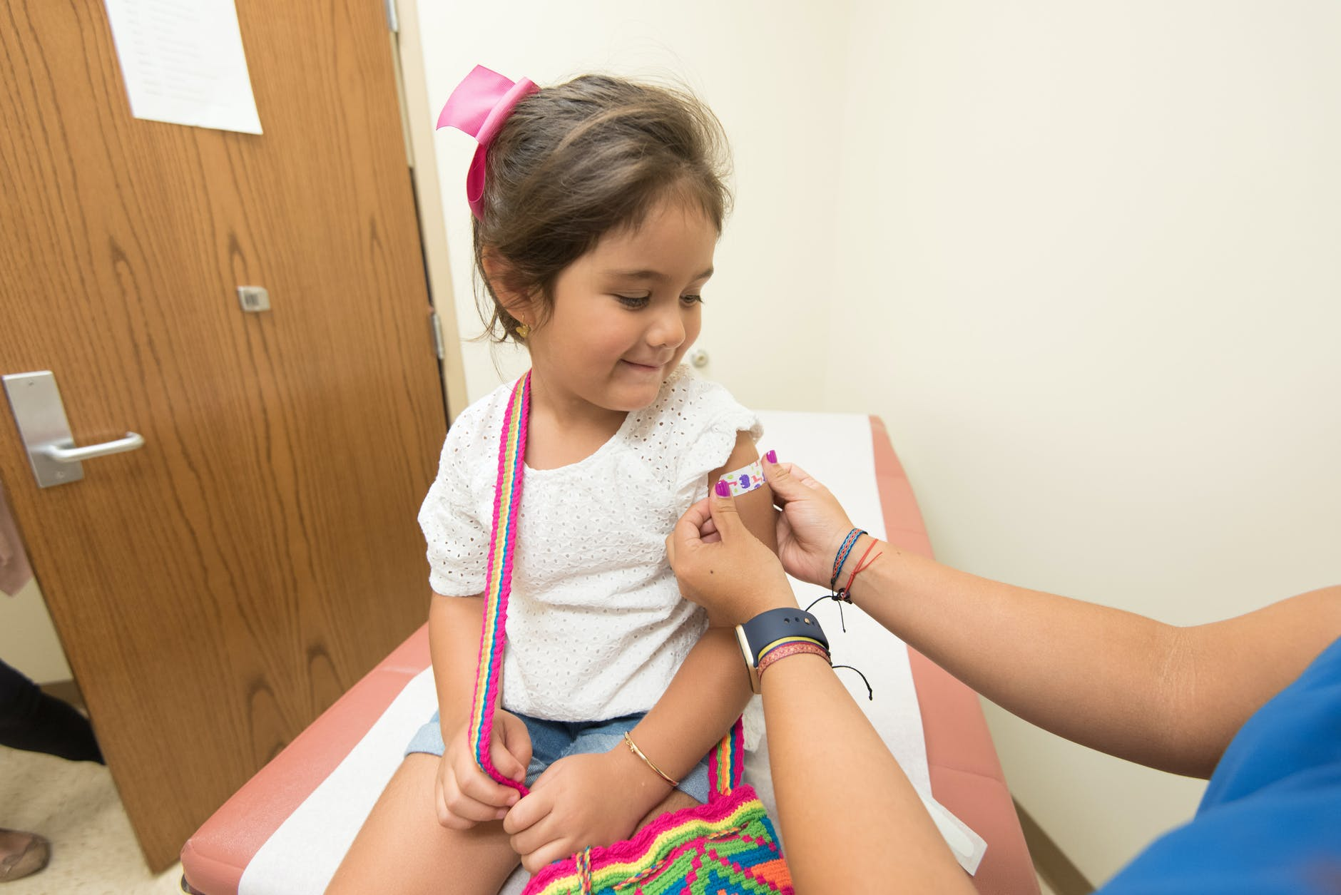 young girl receiving a vaccine