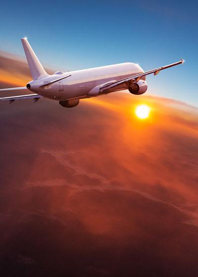 Plane Flying Into the Sunrise