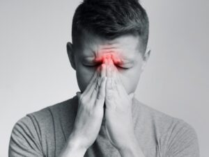 Young man in sinus pain