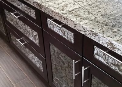 Kitchen counter and cabinetry facias in Scribble, Provance, & Armor.