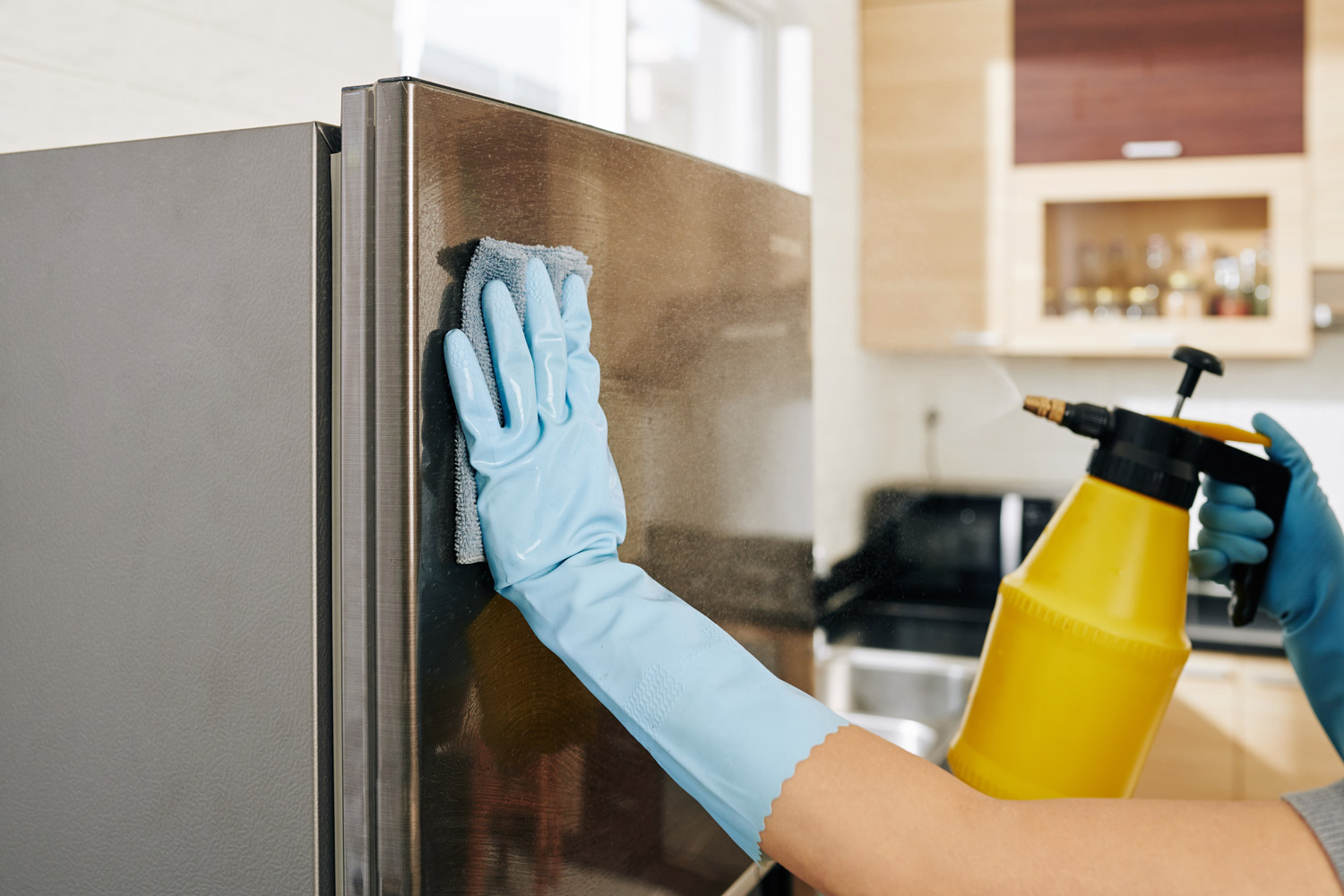 Woman cleaning refrigerator after hurricane damage.