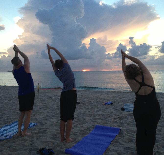 Women - Yoga on the beach