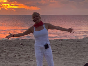 View of yoga instructor with out stretched hands