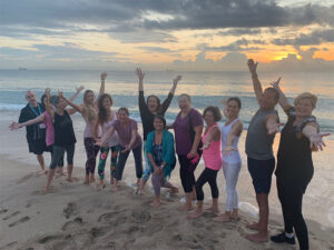 View of yoga class posing together