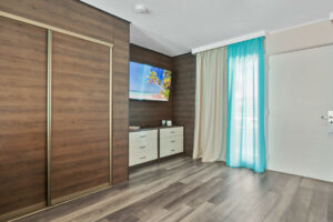 Deco Boutique Hotel-view of tv and storage space