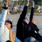 Three yoga students doing yoga positions