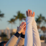 View of hands doing yoga