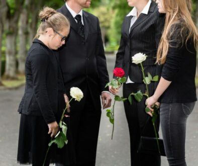 A family reciting funeral poems for dad during his funeral.