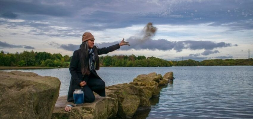A woman scattering the ashes of her loved ones.