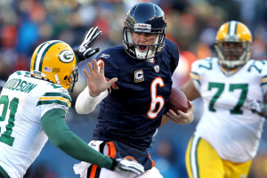 Jay Cutler trying to avoid a sack from Charles Woodson.
