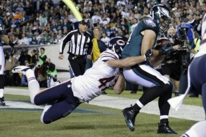 Riley Cooper catches a touchdown pass from Nick Foles during last night's game.