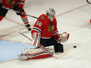 Chicago Blackhawks goalie Corey Crawford makes an effort to stop this goal from scoring in the 2014 Western Conference Finals.