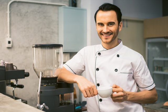 chef-holding-white-tea-cup-887827