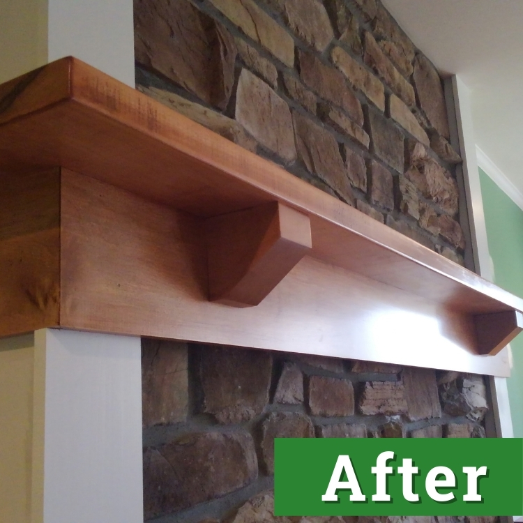 a newly installed custom built wooden fireplace mantel
