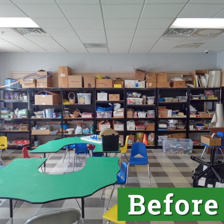 a variety of boxes and containers sit on black shelving in a classroom