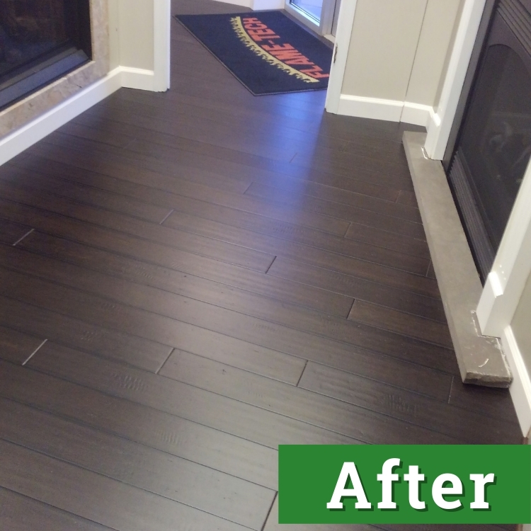 newly installed dark brown wood laminate flooring in front of a fireplace